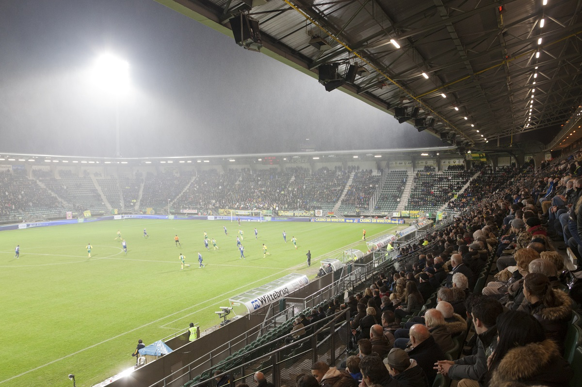 supporters in the Kyocera Stadium of soccer team ADO Den Haag on
